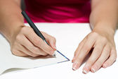 Woman's Hands Holding A Pen Writing A Text — Stock Photo