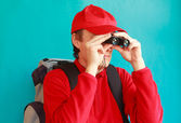 A trekker during an excursion looking through his binoculars — Stock Photo