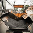 Stock Photo: Tracked paver at asphalt pavement