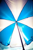 Blue and white umbrella — Stock Photo