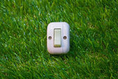 Electrical white rocker light switch on green wall — Stock Photo