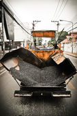 Tracked paver at asphalt pavement — Stock Photo