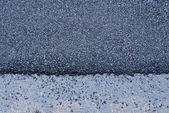 Shiny new black asphalt abstract texture background — Stock Photo