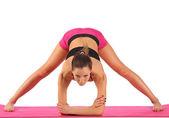 Young beautiful girl yoga posing — Stock Photo