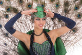 Burlesque dancer with peacock feathers and green dress — Stock Photo