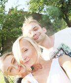Beautiful smiling family posing. — Photo