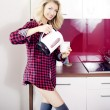 Постер, плакат: Blonde beauty at morning in kitchen