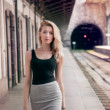 Fashionable girl posing on railway. — Stock Photo #43611171