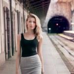 Fashionable girl posing on railway. — Stock Photo