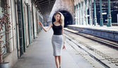 Fashionable girl posing on railway. — Stock Photo