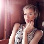 Artistic portrait of blonde woman — Stock Photo