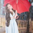Pretty young girl in rain — Stock Photo