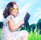 Young girl reading book. — Stock Photo