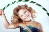 Cute young girl with hulahop — Stock Photo
