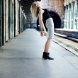 Girl posing on train station — Stock Photo