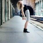 Girl posing on train station — Stock Photo