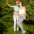 Two young girls posing outdoor — Stock Photo #48440367
