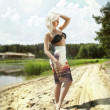 Blonde woman posing outdoor in summer — Stock Photo #48779301