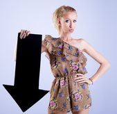 Attractive blonde woman posing with arrow — Stock Photo