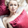 Sexy blonde woman in bed — Stock Photo #50108767