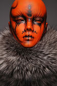 Painted mannequin Girl with in furs — Stock Photo