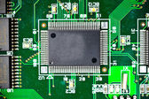 Circuit board with electronic components macro background — 图库照片