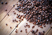 Coffee bean on old table, background — Stock Photo