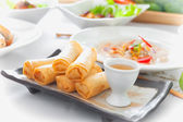 Delicious thai spring rolls with  sauce on dish — Stock Photo