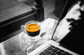 Laptop and hot cup of coffee on wood table, business concept  — Photo