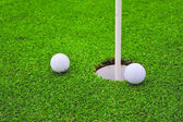 Two golf balls on golf course putting green — Stock Photo