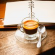 Notebook and coffee cup on old wooden background, business conce — Stock Photo #46898089