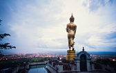 Buddha standing on a mountain Wat Phra That Khao Noi, Nan — Stock Photo