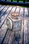 Vintage torch on old wood floor texture — Foto de Stock