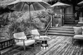 Black and white Armchairs and a table on an open terrace  — Foto Stock