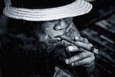Very old Man smoke a cigarette  — Stock Photo