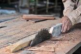 Carpenter working on woodworking machines — Stock Photo