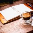 Notebook and coffee cup on old wooden background, business conce — Stock Photo #47444919