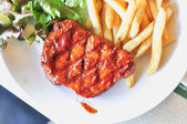 Pork loin steak in a dish Serve with French fries  — Stock Photo