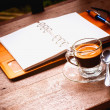 Notebook and coffee cup on old wooden background, business conce — Stock Photo #48084989