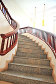 Marble stairs with wooden railing  — Stok fotoğraf