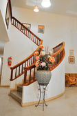 Vase and Marble stairs with wooden railing  — Stock Photo