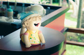 Smile baby doll statue in the home — Stock Photo