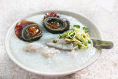 Porridge with century egg or preserved duck eggs. — Stock Photo