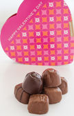 Valentine Chocolate in a heart shaped box on white background. — Stock Photo