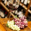 Wine glass, grape and bottles on background — Stock Photo #38814307