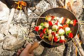 Brochette on the fire — Stock Photo