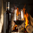 Wine by the fireplace — Stock Photo #39016171