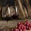 Wine cups and grapes — Stock Photo