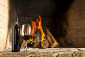 Wine by the fireplace — Stock Photo