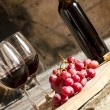 Stock Photo: Wine cups, cork, bottle of wine, grapes